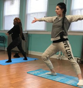 Residents at Southside Center of Hope participate in yoga